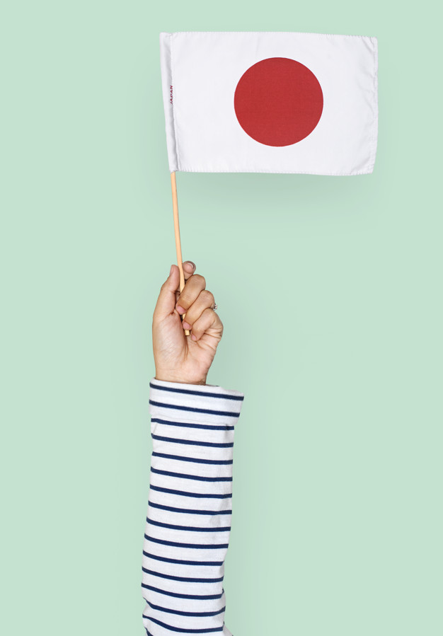 Japanese Flag Holding In A Hand Mockup.