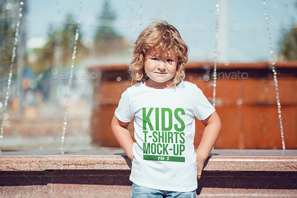 Kid Wearing Realistic T-shirt Mockup.