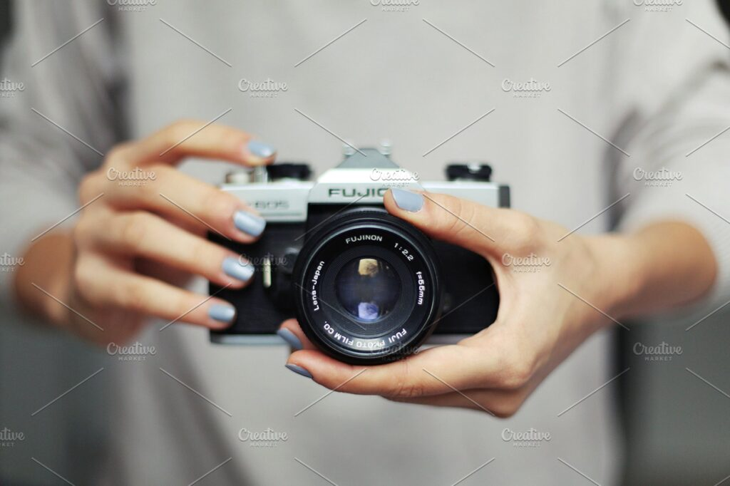 Man Holding Camera On Hand PSD File Illustration