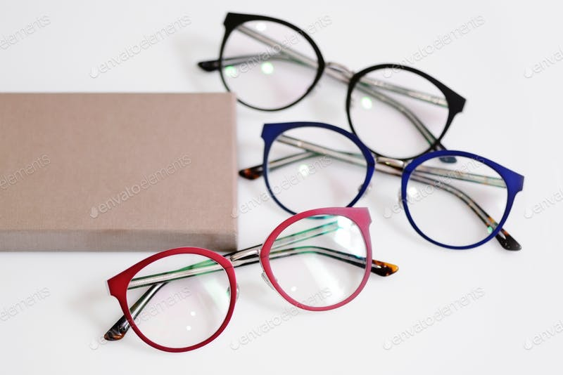Multicolored fashionable glasses with box Mockup PSD