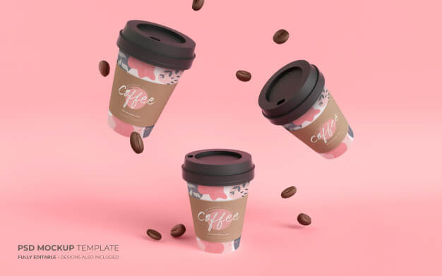 Paper coffee cups and beans in gravity mockup Free Psd