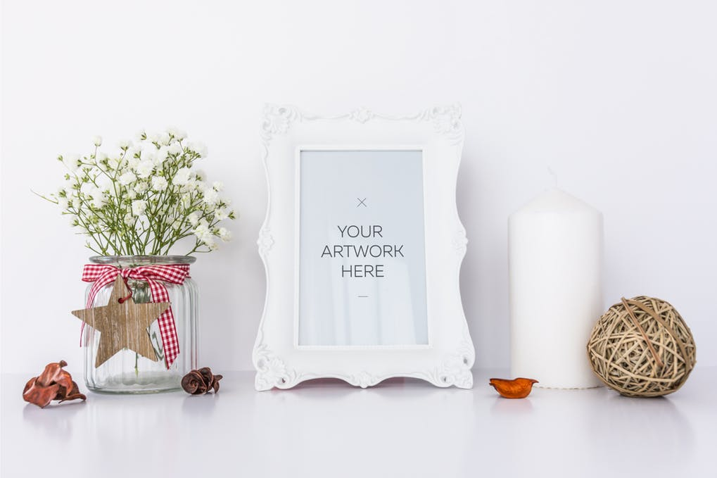 Photo Frame with White Candle and Flowers Mockup