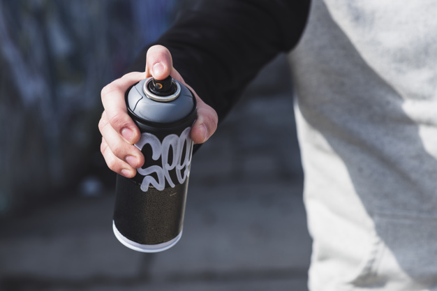 Photo of a guy holding a spray can