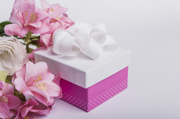Pink Color Attractive Gift Box With Floral Background