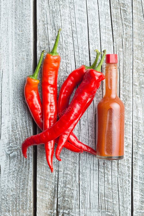 Red Chili With A Sauce Bottle PSD Template