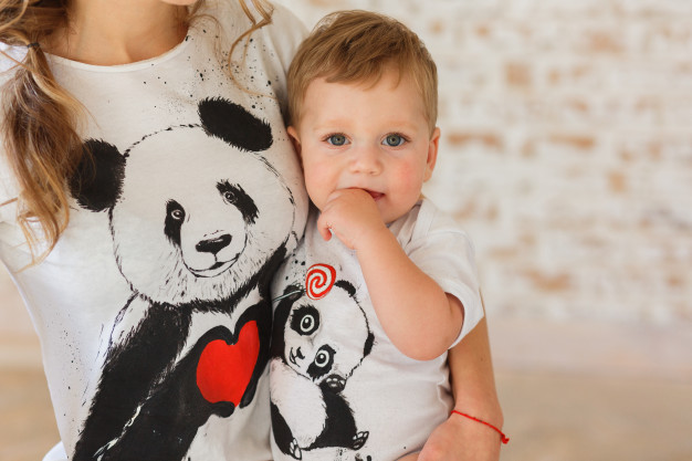 Son And Mom Wearing Panda Printed T-shirt Mockup.