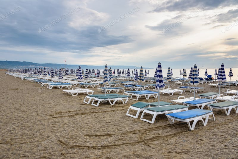Thousand's Of Blue And White Umbrella In Calabrian Beach PSD Template.