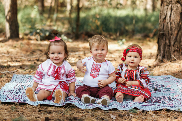 Three Children Wearing Traditional Shirts Of Ukraine Mockup.