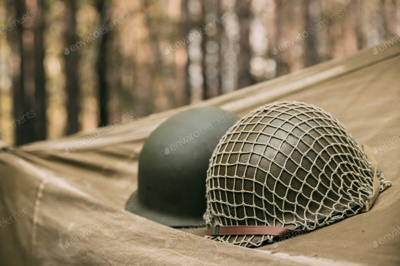 Two Army hard Hat Covered With Net With Blurred Background PSD File Illustration