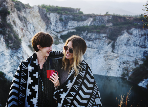 Young Women Traveling WearingBlanket PSD.