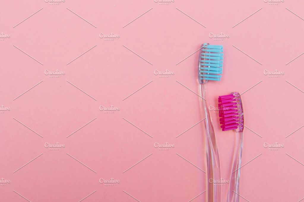 pink and blue toothbrushes