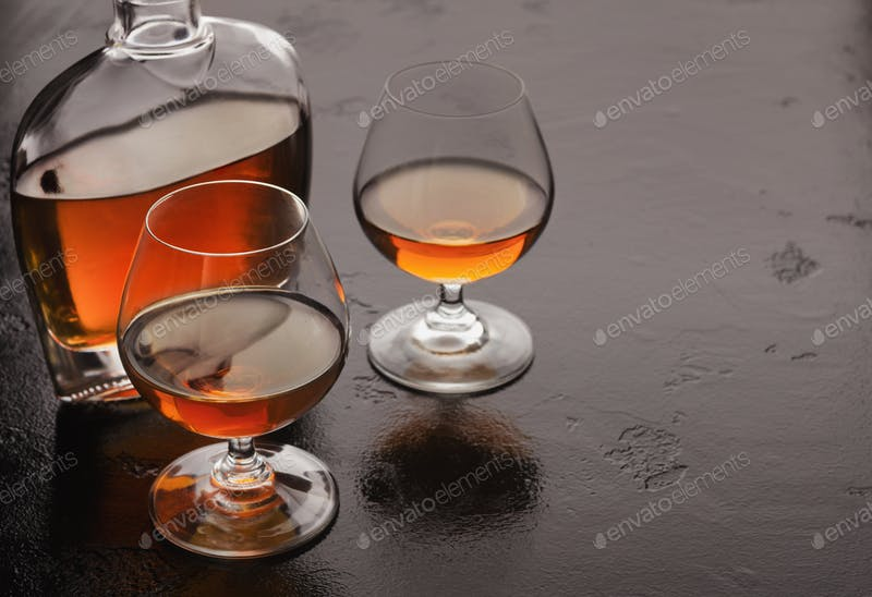 A Bottle And Two Glass Of Brandy PSD Mockup