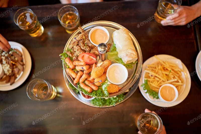 A Food Placed On Table With Many Beer Glass Beside Mockup
