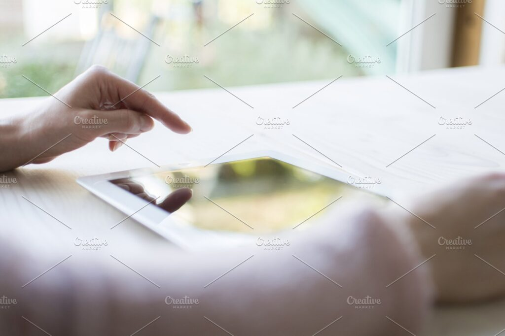 A Hand Using PC Tablet Mockup.