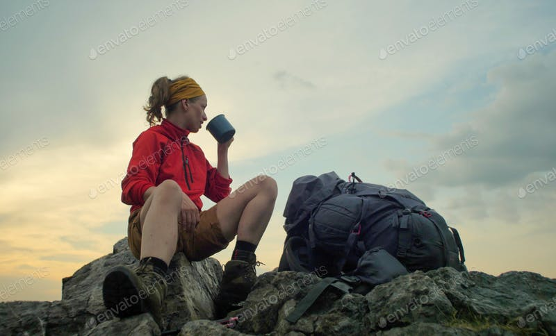 A Hiker With A Travel Mug In Her Hand PSD File