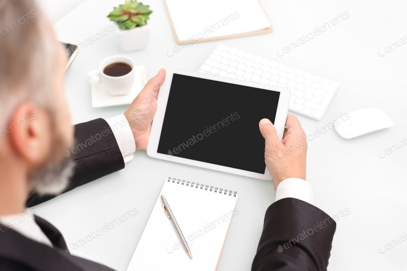 A Man Using Tablet In Hand PSD Scene Template.