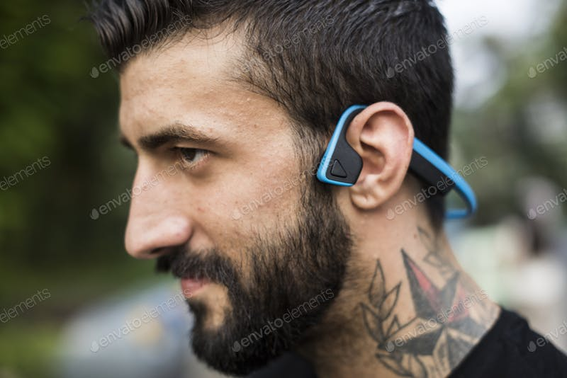 A Man With A Bluetooth Headphone PSD Template.