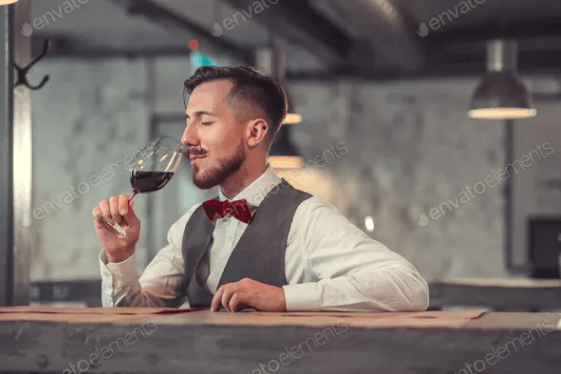 A Man is Drinking Wine Mockup PSD