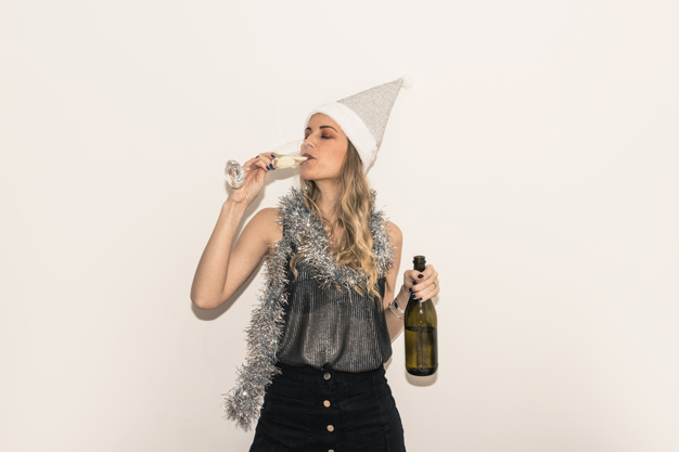 A Women In Santa Hat Drinking Champagne In Glass Mockup