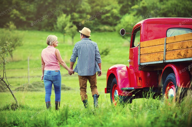 An Old Couple Near A Red Food Truck PSD File