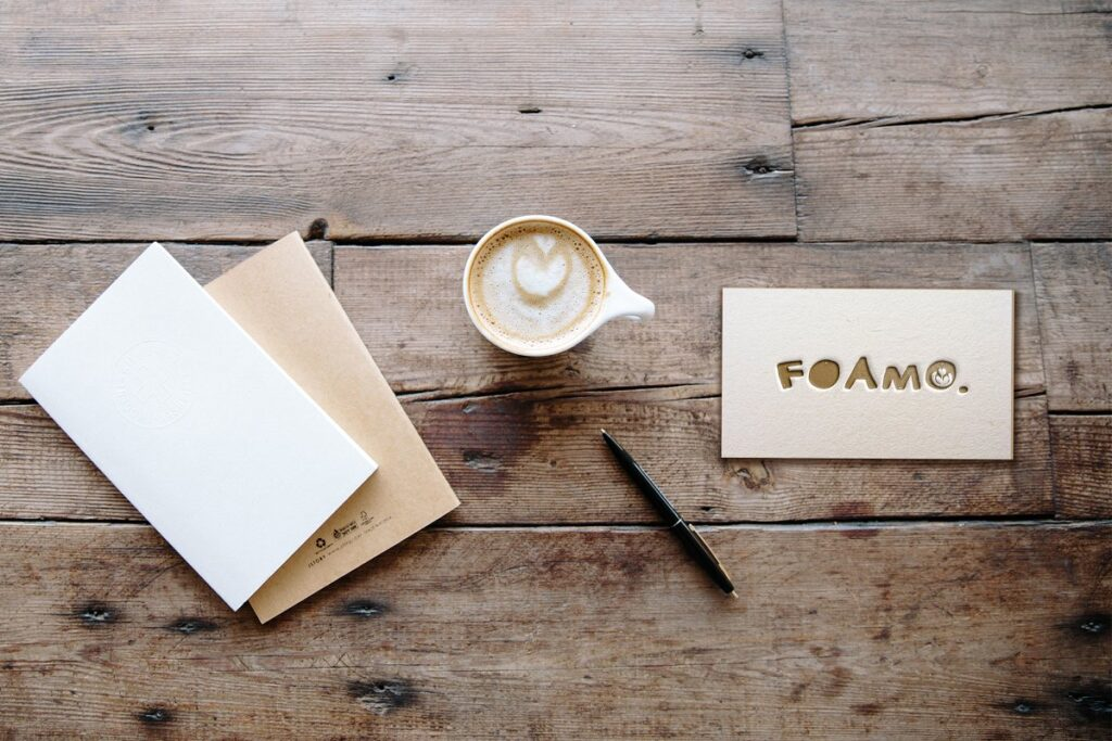 Attractive Image Of A Letterpress Business Card with Coffee Cup And Card Cover Beside