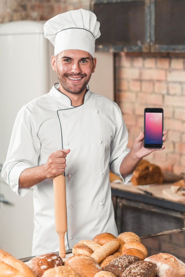 Bakery Chef with a smartphone PSD Mockup