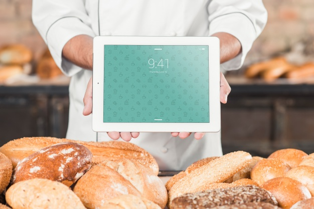 Bakery Mockup With a Tab in a Chef's hand