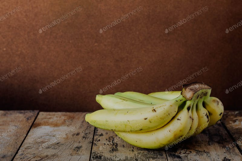 Banana On Wooden Floor PSD With Brown Realistic Background