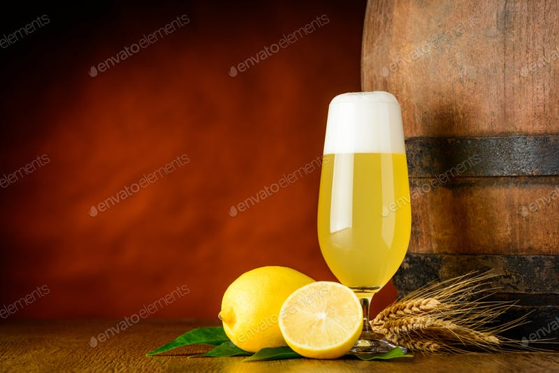 Beer Glass With Lemon kept Beside