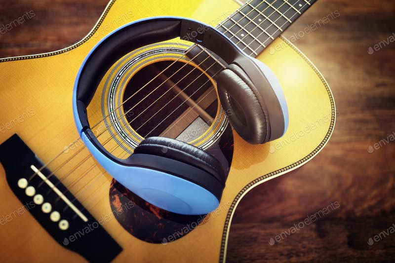 Blue Headphone On A Guitar Mockup.