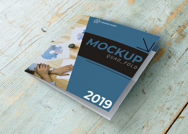 Booklet On a Wooden Table Mockup