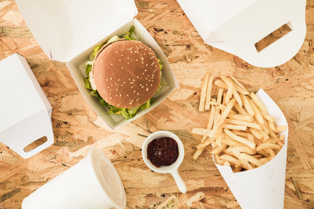 Burger Box On A Wooden Table Mockup.