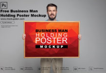 Free Business Man Holding Poster Mockup PSD Template