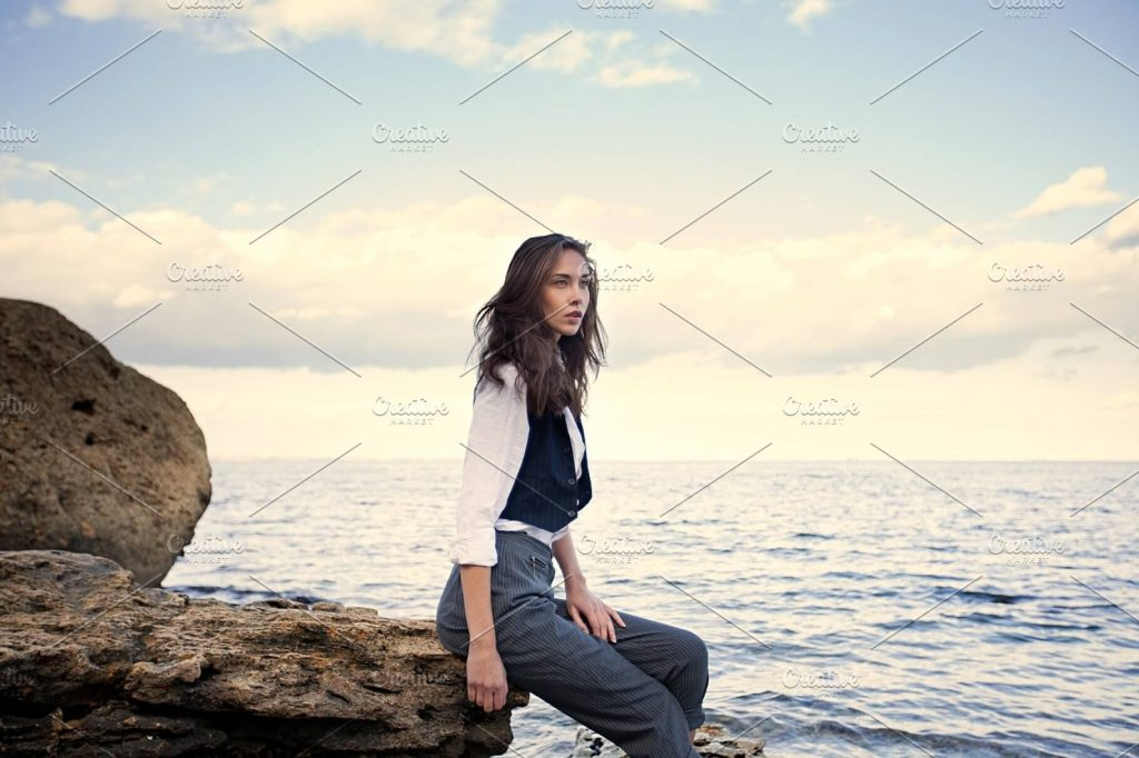 Business Woman Standing Near Big Stones Wearing Suit Vest Mockup.