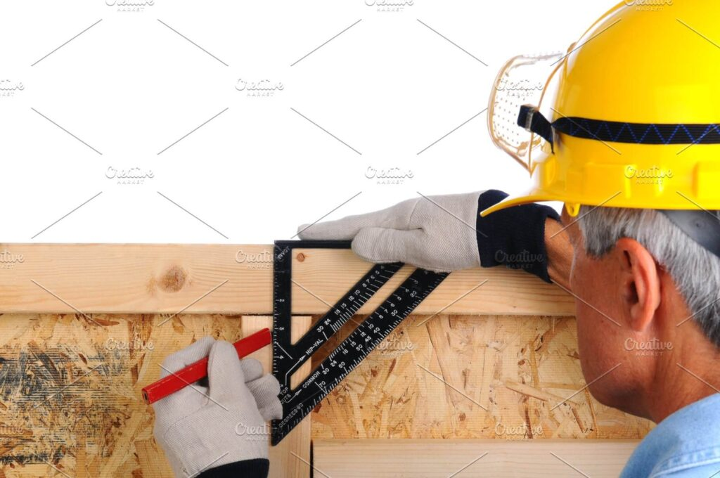 Carpenter Wearing Yellow Helmet And Working