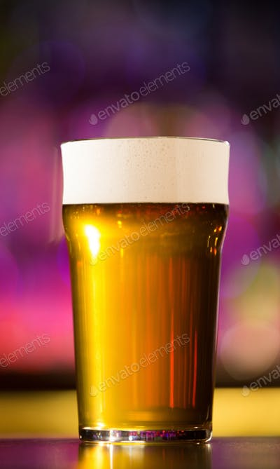 Close View Of A Beer Glass With Purple Color Background