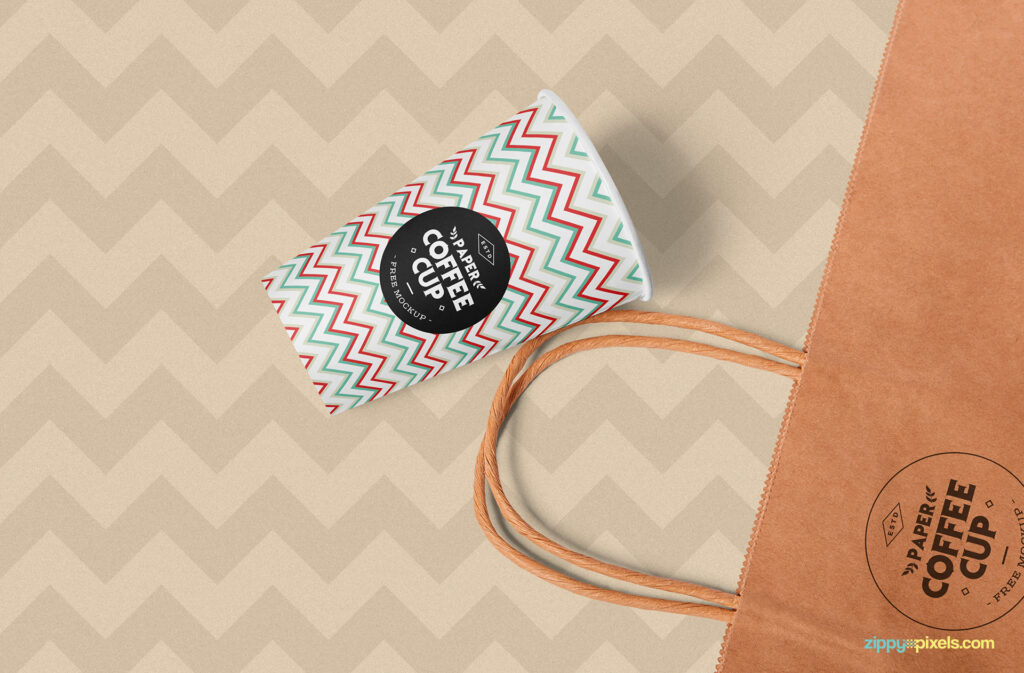 Coffee Cup And A Hang Bag Mockup