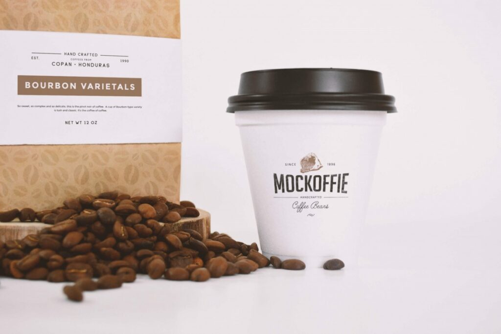 Coffee Packaging Bag With Coffee Cup And Coffee Beans spreaded Mockup