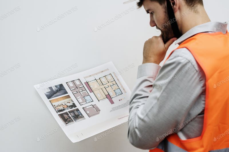 Constructor In A Safety Vest Looking at The Project Template.