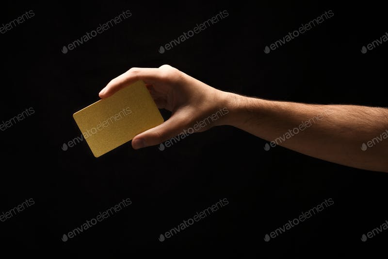 Crop Hand Holding Golden Color Business Card On Hand Mockup