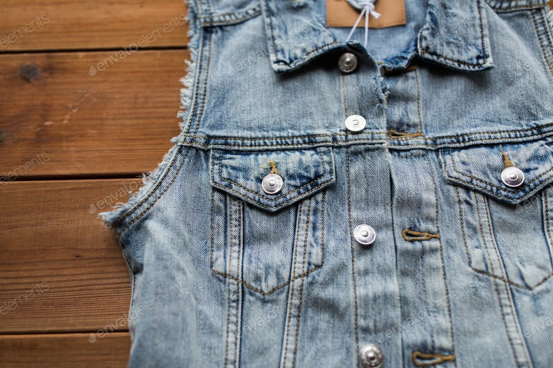 Denim Vest On The Wooden Surface Mockup.