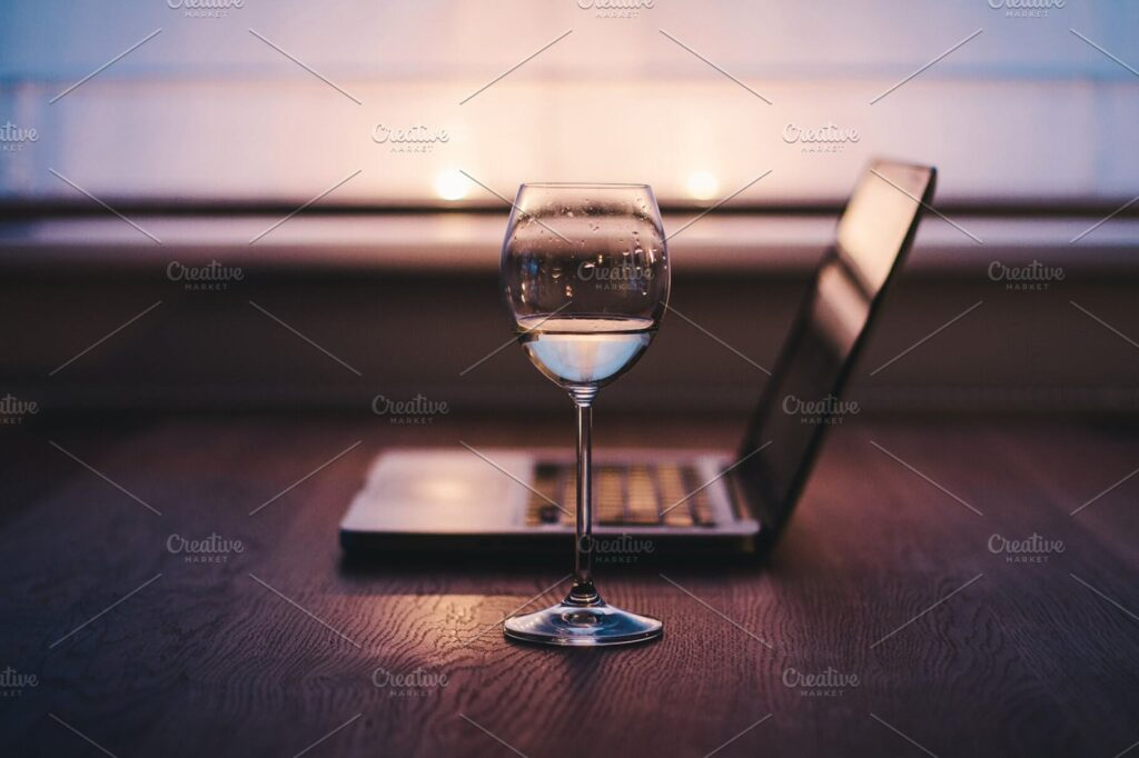 Elegant Scene Of A Laptop And Wine Glass Beside Mockup