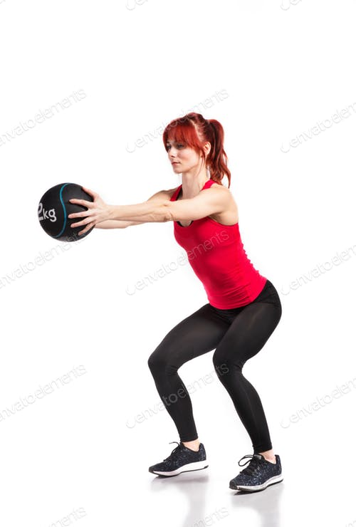 Fitness Woman In Red Tank Top Holding A Ball PSD