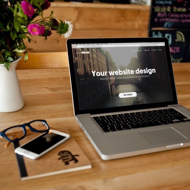 Free Laptop Mockup PSD File.