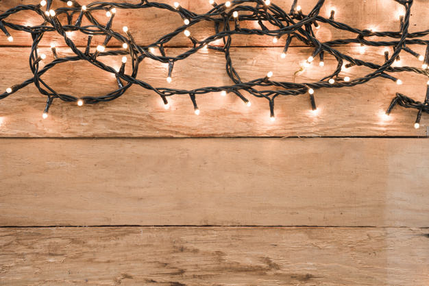 Free Photo Of Burning Garland On Wooden Table