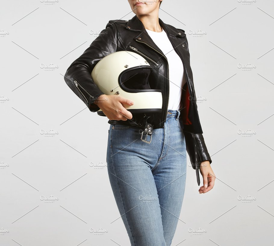 Girl Wearing Bikers Jacket And White Helmet On Hand