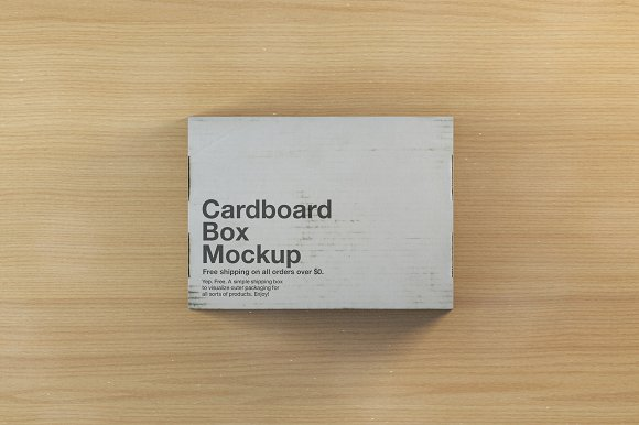Grey Color Shipping Box On Table Mockup