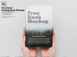 Free Hand Holding Book Mockup PSD Template