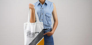 Free Hand Holding Tote Bag Mockup PSD Template