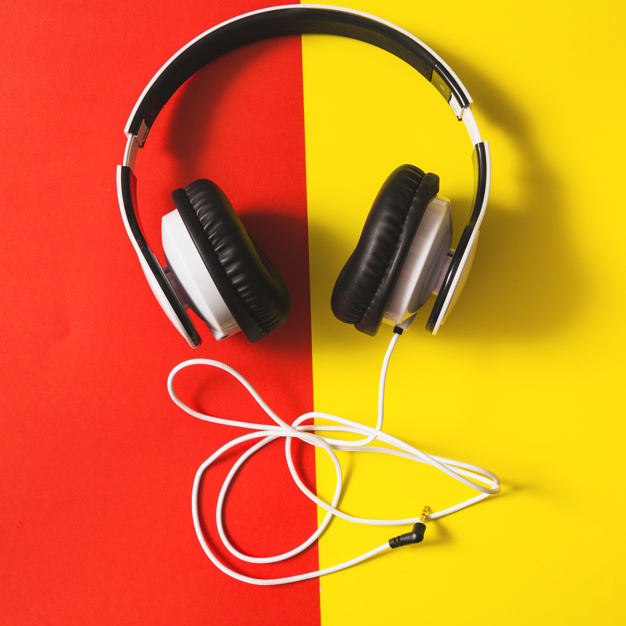 Headphone Placed On A Dual Red And Yellow Colored Background Mockup.